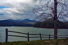 Cold Cloudy Day (mevans4272) Tags: lake cloudy sky fence grass tree mountains late afternoon landscape