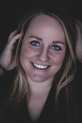 DENS6775-3 (YouOnFoto) Tags: blue eyes blauwe ogen smile glimlach moody emotional intens intense dark black portret portrait fujifilm xt20 systeemcamera girl woman vrouw meid meisje blond blonde