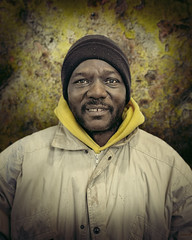 Awesome Dave (mckenziemedia) Tags: man portrait portraiture homeless homelessness people face stockingcap hat winter coat yellow smile chicago urban street streetphotography city