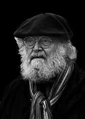 Portrait (D80_527613) (Itzick) Tags: denmark copenhagen candid bw matureman blackbackground bwportrait beard beret glasess streetphotography scarf portrait face facialexpression d800 itzick