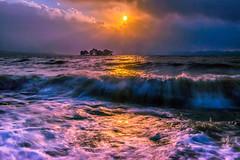 sunset 4321 (junjiaoyama) Tags: japan sunset sky light cloud weather landscape orange contrast color lake island water nature spring wave storm rough muddywater shallow bog sunrays beams sunburst rocks rain