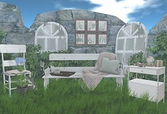 It's not a forgotten place (Rose Sternberg) Tags: second life deco decor home garden a sways sway acorn marketplace gift botanical ser for bloom event wood iron bench seat white arch mirror rustic dinning chair frames metal cabinet tin candle cluster pinkfela tray with tea cookies boots sith kitten grass spring place blue sky furniture secondlife