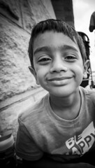This smile has all the colors in the world (sanglap1) Tags: portrait child kid innocence travel newyork nyc brooklyn blackandwhite bw blackandwhitephotography candidshot moment