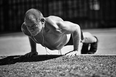 pushing down the world (gro57074@bigpond.net.au) Tags: pushingdowntheworld streetphotography street portrait posed strong 2019 march cbd sydney darlingharbour pushups strain fit muscles man f14 artseries 105mmf14 sigma d850 nikon training exercise strength core outdoor fitness guyclift monochrome monotone mono blackwhite bw