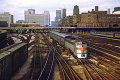 rr346s (George Hamlin) Tags: illinois chicago roosevelt road railroad passenger train burlington northern bn westbound suburban commuter dinky emd e8 9938 diesel locomotive buildings skyline tracks yard gallery coaches bilevel photo decor george hamlin photography