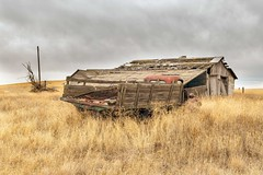 Last Load (garshna) Tags: truck abandoned rusty stakebed farm barn sky clouds field grass pole landscape outdoors isolated