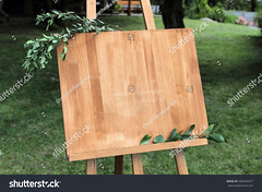 Wooden easel with a board (ig_royal6969) Tags: easel canvas board wooden blank art background empty stand drawing artist retro wood design old concept picture grunge display text creation business template object frame sign message creative sketch draw blackboard texture vintage chalkboard decor interior idea backdrop workshop wedding rack holder welcom inscription welcome leaves branch outdoors grass green sale shutterstock