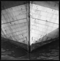waves eater (ukke2011) Tags: hasselblad503cw sonnar1504cf ilforddelta100 selfdeveloping kodak hc110 kodakhc110 analog analogico film pellicola 6x6 120 square bw blackandwhite monochrome harbor porto boat barca sea mare