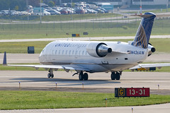 N436AW - 2002 build Bombardier CRJ200LR, taxiing for departure at Milwaukee (egcc) Tags: 436 7734 airwisconsin billymitchell bombardier crj crj200 canadair kmke lightroom mke milwaukee mitchell mitchellfield n436aw staralliance ua ual united unitedairlines unitedexpress wisconsin