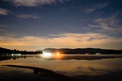 Stars over Island Pond (Northern Wolf Photography) Tags: 12mm astronomy astrophotography clouds em5 lake landscape mountains night pond reflections stars water islandpond vermont unitedstates us