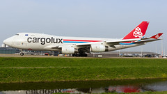 Cargolux 747. (spencer_wilmot) Tags: lxdcv clx cv cvclx cargolux freighter freight cargo 747 747400 747f 747400f boeing b747 b744 b74f quad queenoftheskies widebody winglets water reflections ams amsterdam amseham eham holland netherlands schiphol longhaul departure taxiway aviation aircraft airplane airliner airport apron civilaviation commercialaviation doubledecker flying heavy huge jet jetliner jumbo jumbojet plane ramp runway