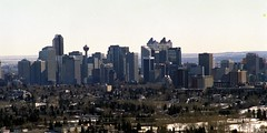 Nose Hill Park 2: Downtown Calgary (pmvarsa) Tags: winter 2002 analog film 135 cans2s kodak gold 200iso kodakgold200 nikonsupercoolscan9000ed nikon coolscan cold sky blue tan brown grass path trail cityscape city skyline trees nose hill canon ftb canonftb classic camera calgary alberta canada ab skyscraper landscape