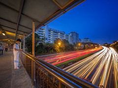 Traffic controller (Rexer Ong) Tags: traffic boy sky outdoor light trails city cityscape nightscape bridge