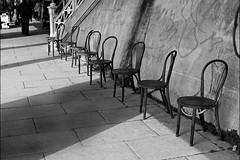 Incarnation (Finding Chris) Tags: street mono chrisbarbaraarps canoneosr canon50mm findingchris storyteller madeiradrive brighton eastsussex pavement incarnation emptychairs blackandwhite bw streetphotography lightandshadows vacant