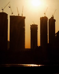 Power towers (Arvind Nandan) Tags: silhouetteaward urbanscape cityscape skyline urban city outline stately power backlit backlight sun morning silhouettes silhouette tall skyscrapers towers