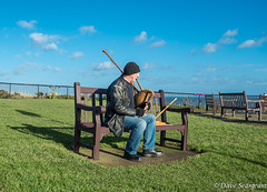 The Lone Piper (daveseargeant) Tags: whitby north yorkshire coast sea seaside beach lone bagpipes piper bench leica x tip 113