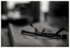 Reading glass with news paper  ( day - today - things. ) (Rajavelu1) Tags: macrophotography closeup readingglasses newspaper blackandwhitephotography art creative bokeh depthoffield backgroundblur dslr availablelight