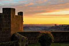 Sunset in Tuscania, Central Italy (Claudio_R_1973) Tags: tuscania wall centralitaly tower monument park antique medieval hills sunset romantic pink pastel outdoor landscape art colorful vivid italia lazio