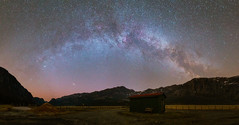 Milky way arching over nordic landscape (kenthelleland) Tags: milkyway astrophotography nightshot nightimage night darkness landscape nature astronomy universe panorama canon canon6d sigma sigmaart breakthrough nightsky stars starry starrynightsky landscapeastrophotography norge norway rogaland landskap spring earlysummer galaxy house cabin mountains pano m31 andromeda