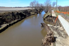 A section of Wayne walking trail has collapsed into Logan creek (ali eminov) Tags: wayne nebraska creeks logancreek trails walkingtrail flooddamage naturaldisasters