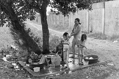 Water Pump (Beegee49) Tags: street family mother children watching washing clothes water pump blackandwhite monachrome bw panasonic fz1000 conception negros occidental philippines asia happyplanet asiafavorites