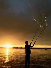 Bubble guy 2 (briandjan607) Tags: hugebubbles sunlight evening silhouette sunset bubbles sandiegoharbor harbor seaportvillage sandiego california ca