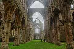 Tintern Abbey (Geoff Henson) Tags: ruin historic ancient medieval abbey monastry architecture pillars grass people monmouthshire wales chepstow