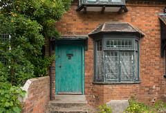 Behind the green door (Winnipeg Canada) Tags: door green greendoor cottage brick brickbuilding