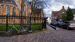 Bike (Alfred Grupstra) Tags: architecture netherlands street europe urbanscene bicycle amsterdam buildingexterior outdoors city builtstructure house history old dutchculture famousplace town bike church fence