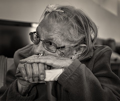 'Lives Lived' (Canadapt) Tags: woman elder repose glasses hands seated cane home bw colares portugal canadapt