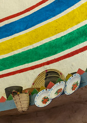 Decoration inside a traditional al Ousha Attiniya house, Jizan Province, Jizan, Saudi Arabia (Eric Lafforgue) Tags: arabia architecture basket colorimage colored decoration design display drawing enamel gazan geometric geometricalmotives geometry gizan hanging heritage home homeinterior house indoors inside interior jazan jzan ksa middleeast multicolored nopeople ornate painted photography plates saudiarabia saudi180684 tihama tihamah tradition traditional travel typical vertical wall jizan jizanprovince