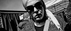 Look into my eyes. (Baz 120) Tags: candid candidstreet candidportrait city contrast street streetphotography streetphoto streetcandid streetportrait strangers rome roma ricohgrii europe women monochrome monotone mono market noiretblanc blackandwhite bw urban life portrait people italy italia grittystreetphotography faces decisivemoment