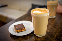 Glass of Coffee Latte with Pastry (josve05a_at_Wikimedia) Tags: hot drink glass table delicious tasty coffee beverage refreshment cafe break cafeteria warm chocolate plate snack foam pastry dessert milk caffeine latte cookies coffeecup cafes coffeelatte macchiato