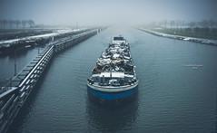 One man's trash is another man's treasure (Ingeborg Ruyken) Tags: sneeuw morning trash maximakanaal empel ship boat mist instagram 500pxs fog natuurfotografie ochtend flickr snow