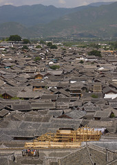 Roof Tops Of Old Town, Lijiang, Yunnan Province, China (Eric Lafforgue) Tags: a0007645 architecture asia buildingexterior builtstructure china chineseculture city colorpicture day dayantown elevatedview groupofpeople highangleview history idyllic lijiang mansion nature nopeople oldtown outdoor outdoors realpeople roof rooftops series shangrilacounty town traditionalculture traditionallychinese tranquility travel unescoworldheritagesite vertical yunnan yunnanprovince