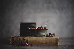 Redcurrants #3 (Janet_Broughton) Tags: lensbaby twist60 stilllife dark food redcurrants book vintagebooks bakeware vintage