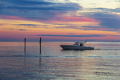 A Mariner's Delight (SteveFrazierPhotography.com) Tags: boat yacht horizon sunset dusk fishing poles shore shoreline clouds channelmarkers waves reflections beautiful serene peaceful waterscape lights navigation motors signs pink blue yellow orange charlotteharbor charlottecounty puntagorda florida fl stevefrazierphotography fisherman fishermansvillage pastel colorful colors scene water birds wake cloudy fowl