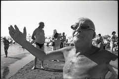 (Embrace Me) (Robbie McIntosh) Tags: leicamp leica mp rangefinder streetphotography 35mm film pellicola analog analogue negative leicam analogico blackandwhite bw biancoenero bn monochrome argentique autaut dyi selfdeveloped is dead beach swimsuit shoreline rodinal bathers tan elmarit leicaelmarit28mmf28iii elmarit28mmf28iii 28mm man speedo naked summer summertime singer lidomappatella mappatellabeach