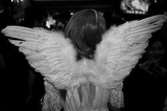 angel of Shibuya (jrockar) Tags: tokyo shibuya japan streetphoto street streetphotography candid decisive moment instant documentary travel trip photography bw mono bnw blackandwhite olympus mju mjuii fujifilm fuji200 analog analogue film filmphotography filmisnotdead jrockar janrockar voidtokyo angel wings life people ishootfilm nippon girl