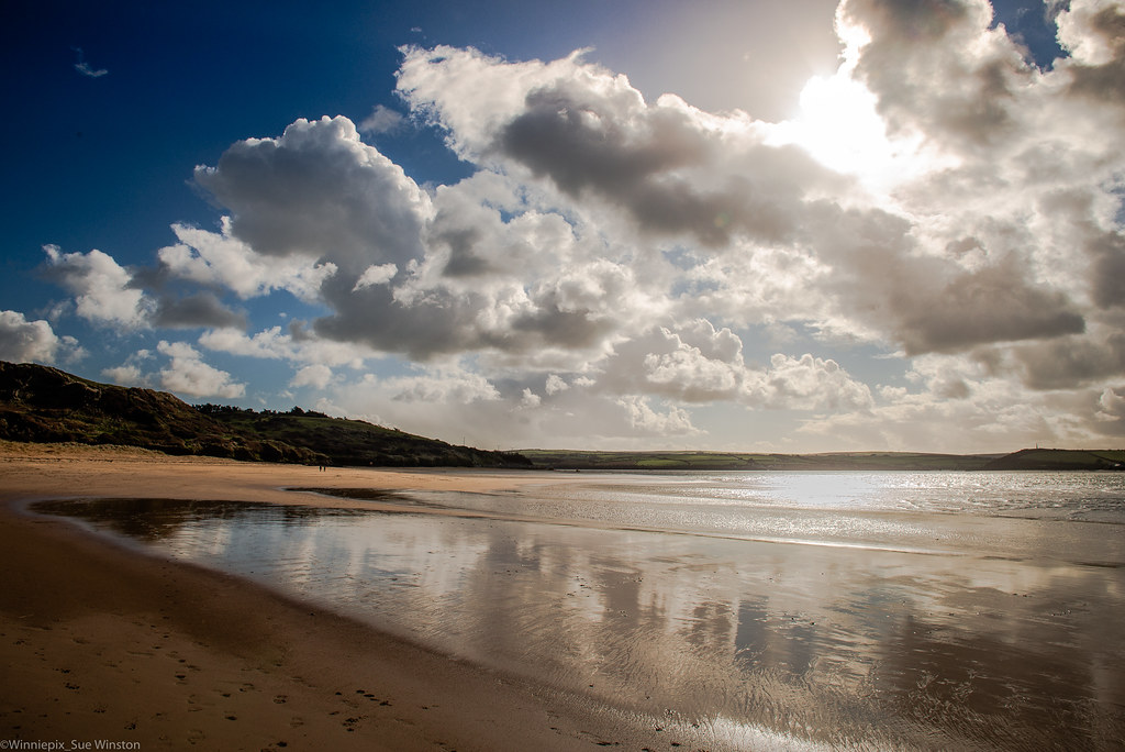 Breaking through the clouds, at Rock beach, Cornwall