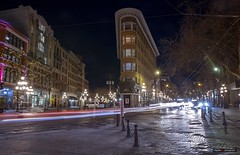 Night Flashes By The Hotel Europe (Clayton Perry Photoworks) Tags: vancouver bc canada winter explorebc explorecanada night lights gastown hoteleurope skyline