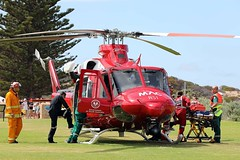 Unloading (adelaidefire) Tags: horseshoe bay fleurieu peninsula south australia helicopter bell 412er bell412er port elliot country fire service australian cfs sacfs sa state emergency ses coast surf life saving association slsa ambulance saas medstar mac motor accident commission retrieval vhvas