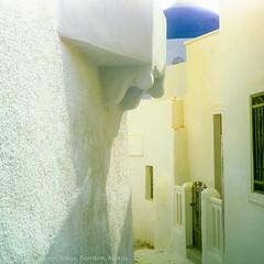 Street to Chappel, Santorini, Greece (WernerSchoen) Tags: santorini thira greece white blue europe griechenland narrow street yellow 6x6 film yashica analog gasse schmal kapelle chappel church