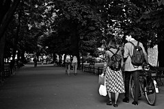 Walk in the park (Roi.C) Tags: monochrome black bw people women outside outdoor candid ligh europe nikon d5300 nikkor photography photo digital shot street city human humans persons picture image camera interesting girl female talking may 2017 18140mm man walking tree trees road bicycle krakow poland romantic composition