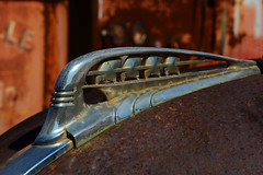 Hood Ornament (davidwilliamreed) Tags: old rusty crusty metal chrome plymouth car auto automobile hood ornament rust decay weathered weatherbeaten oxidized oxidation abandoned neglected forgotten dof simpsonfarm hallcountyga patina textures