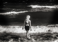 The Dark Water (Rigamer) Tags: dark black white blackandwhite bw girl woman lady blonde walking standing travel vacation mysterious looking wet lost wind blowing splash waves beach sea ocean water ripple endless infinity photo photography