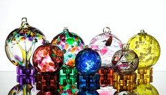 Family Portrait (Karen_Chappell) Tags: glass orb sphere round circle ball globe white stilllife seven 7 reflection blue pink yellow purple green red multicoloured colourful colours colour color collection orange product