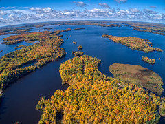 Aerial View of Fall Colors on Island Lake by Duluth in Northern Minnesota during early October (JacobBoomsma) Tags: maple falllandscape landscape woods water autumn north bluesky trees pine highangleview fall hill fallleaves aspen minnesota blue lake forest autumnleaves colorful fallcolor soudan state park above plane island duluth