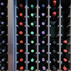 Wine Bottles 3 (Explored) (remiklitsch) Tags: wine bottles abstract display store restaurant wallys santamonica red black green blue purple caps remiklitsch iphone