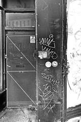 doorway (Harry Halibut) Tags: 2019©andrewpettigrew allrightsreserved imagesofsheffieldimagessheffieldarchitecture sheffieldbuildings contrastbysoftwarelaziness noiretblanc blackwhite blancoynegro blanc weiss noire schwatz bw zwart wit bianco nero branco preto 2019 © andrew pettigrewall rights reservedimages sheffield images architecturesheffield buildingscontrast by softwarelazinessnoiretblancblack whiteblanco y negroblancweissnoireschwatzbwzwartwitbianconerobrancopreto sheff1903110686 gibraltar street door doorway grille mesh metal graffiti shop empty derelict vacant